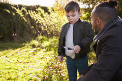 Boy And Father Playing With Feather In Autumn Garden Royalty Free Stock Photo