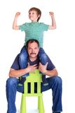 Boy on father's shoulders. Happy boy enjoying sitting on his  father's shoulders Stock Photo