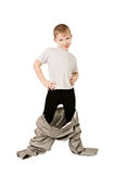 A boy in father's trousers Royalty Free Stock Photos