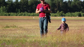 Boy with the father spend time together in the field stock video footage