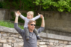 Boy on fathers shoulder Royalty Free Stock Photo