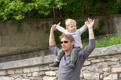 Boy on fathers shoulder Royalty Free Stock Image