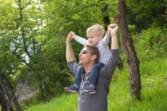 Boy on fathers shoulder Stock Image