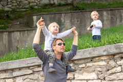Boy on fathers shoulder Stock Photography