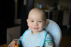 Boy in feeding chair Royalty Free Stock Images