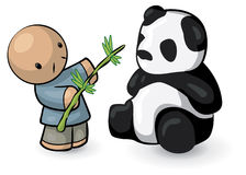 Boy feeding panda bear Royalty Free Stock Photography