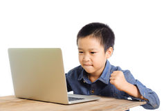 Boy feel excite in front of new notebook. On wood desk Royalty Free Stock Image