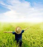 Boy feel good on rice field Stock Photo