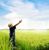 Boy feel good on rice field Stock Photos