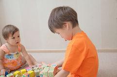 Boy feeling hurt about sister's crashed his construction Stock Image