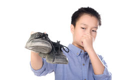 Boy feeling unhappy with bad smell white sock Stock Photo