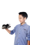 Boy feeling unhappy with bad smell white sock. Selective focus on the old and dirty shoe, Young Asian boy feeling unhappy with bad smell black leather shoes on royalty free stock photos