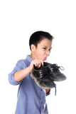 Boy feeling unhappy with bad smell white sock. Selective focus on the old and dirty shoe, Young Asian boy feeling unhappy with bad smell black leather shoes on stock photos