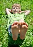 Boy feet raised Stock Image