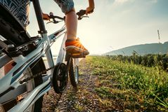 Boy feet in red sneackers on bicycle pedal close up image Royalty Free Stock Photography