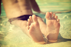 Boy feet in a swimming pool, vintage process Royalty Free Stock Images