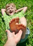 Boy Feet tickle Stock Image