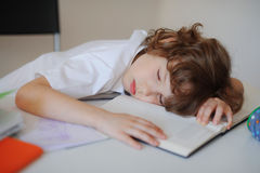 The boy fell asleep in the classroom sitting at a school desk Royalty Free Stock Photography