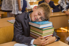 Boy fell asleep hugging the book Royalty Free Stock Photos