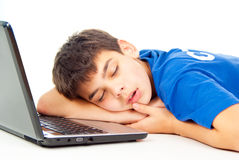 Boy fell asleep at the notebook Royalty Free Stock Photography