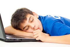 Boy fell asleep at the notebook isolated Stock Photo