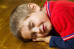 Boy fell asleep at the table Royalty Free Stock Image
