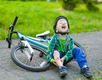 Boy fell from the bike in a park Stock Photography