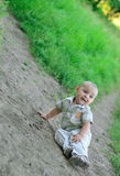 The boy fell and laughs Stock Photography