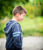 Boy fell on the playground. And began to cry Stock Photo