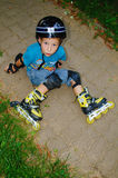 The boy fell roller skates Royalty Free Stock Images