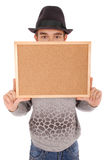 Boy in felt hat holds billboard Royalty Free Stock Images