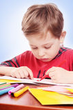 Boy with felt-tip pen Royalty Free Stock Photo