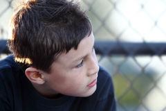 Boy by a fence Royalty Free Stock Photo