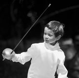 Boy Fencing. Boy in full fencing suit with sword Stock Image