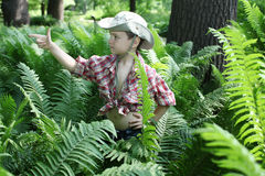 Boy among fern Stock Photos