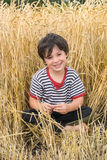 The boy on field Royalty Free Stock Photo