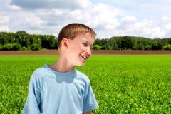 Boy in the field Stock Photo