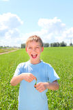 Boy in the field Royalty Free Stock Photo