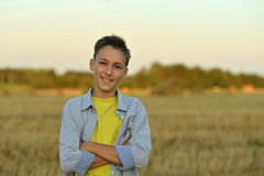 Boy in field enjoying nature Stock Images