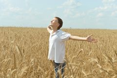 Boy in field enjoys nature Stock Photos