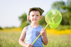 Boy in Field Holding Green Bug Net Royalty Free Stock Photography