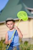 Boy in Field Holding Green Bug Net Royalty Free Stock Photo