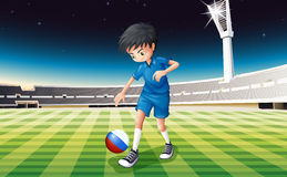 A boy at field using ball with flag of Netherlands Stock Images