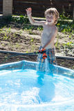 Boy fills up with water Royalty Free Stock Photo
