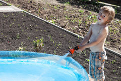 Boy fills up with water Stock Photo