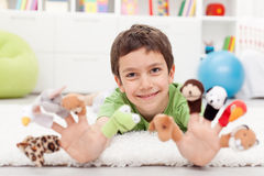 Boy with finger puppets Stock Images