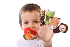 Boy with finger puppets. Boy playing with finger puppets - isolated Stock Photo