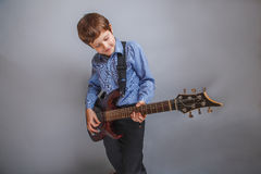 Boy fingered guitar strings Stock Photo