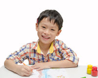 Boy finishing his artwork Royalty Free Stock Images