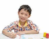 Boy finishing his artwork Royalty Free Stock Images